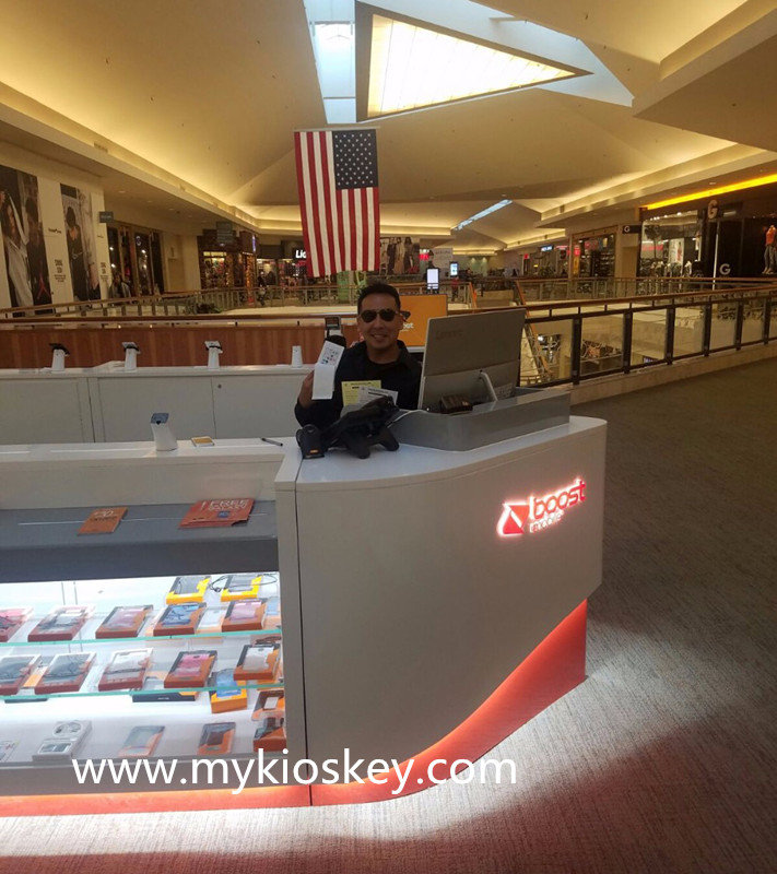 this kiosk size is 5m by 2.5m,to match logo,mainly used white,bottom a little orange.countertop has some mobile phone displays,outside has some showcases to display cell phone accessories.
